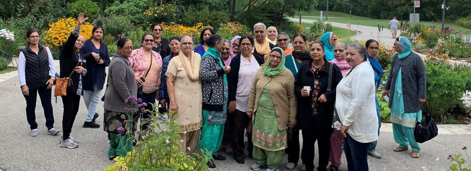 Group of diverse seniors visiting Terra Cotta Conservation Area to learn about health and wellness.