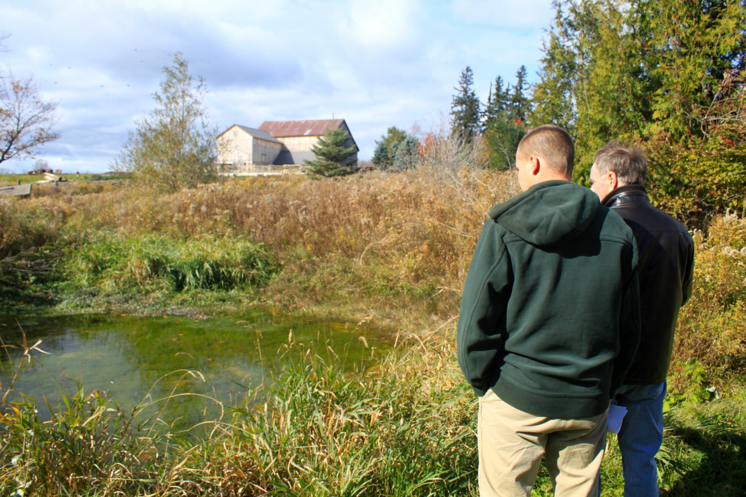 CVC staff consulting with a landowner on their farm