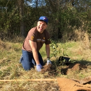 UPS employee planting a tree for a corporate tree planting
